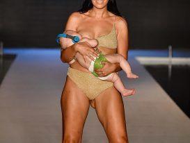 Reactions of people on model walking ramp while breastfeeding baby